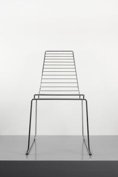 This minimalesque chair was made in 2006 but I doubt this timeless design will ever age. Beautiful!