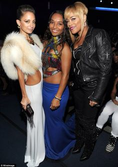 Nicole later accessorised her outfit with a fur stole as she posed with TLC's Chilli and T-Boz