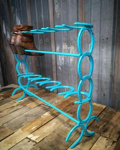 6 Pair Horseshoe Boot Rack, Country Boot Storage by SteelLovedShoes horseshoe art, horseshoes, horse shoe, horse shoes, horseshoe boot rack, shabby chic, farm chic, country entryway, country mud room, farm entryway, barn mud room, welded, rebar