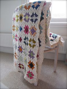 granny square blanket finished by mabelrosemolly, via Flickr