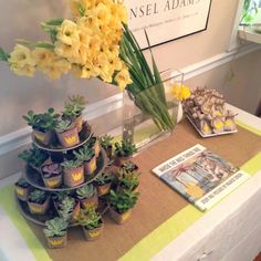 """Favor table: succulents wrapped in burlap and linen baggies both embellished with Max's """"wild thing"""" crown. """"Where the Wild Things Are"""" guest book."""