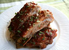 BBQ Red Pepper Jelly Spareribs ((It just so happens that I have a jar of homemade red pepper jelly in my pantry. Though I would still prefer the grill over the oven!))
