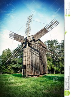 Old Windmills | Old wooden traditional ukrainian windmill over blue sky with clouds ...