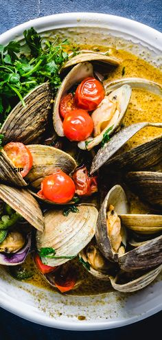 Quick and easy Thai green curry clams. Recipe uses Littleneck clams, coconut milk, cherry tomatoes, limes, and cilantro. Any small clams can be used. Seafood Appetizers Seafood Appetizers Appetizers Appetizers for a crowd Appetizers parties Cilantro Recipes, Fish Recipes, Seafood Recipes, Asian Recipes, Mexican Food Recipes, Healthy Recipes, Cilantro Ideas, Appetizers For A Crowd, Seafood Appetizers