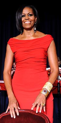stunning First Lady in red at the annual banquet. She accessorized her hand-draped Prabal Gurung gown with drop earrings and cuffs from Bochic (top) and