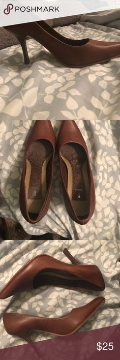 Brown Pumps Super cute brown pumps. Worn a few times. Lightened blotches comes from spraying disinfectant spray. Bakers Shoes Heels
