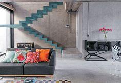 blue dog-legged stairs against concrete walls