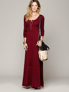 Free People Miles of Henley Dress, 88.00Long sleeved knit henley dress with half button down front. Pieced material at the bottom with unfinished hem.