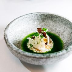 Scampi, parsley, dashi, puffed rice, watercress consommé.