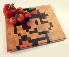 No wonder the world is running out of pixels! Endgrain hardwood chopping board with retro pixel by JJProducts, $149.00