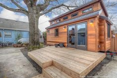 Mike and Laura's tiny house is built on a trailer, helping avoid development and permit fees. It sits in the back yard of a house in Portland, which they own and now rent to supplement their income.