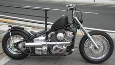 Yamaha V-Star 650 custom with sportster tank and 2-into-1 megaphone exhaust