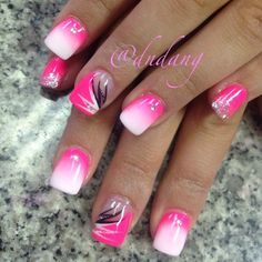 A pink themed gradient inspired nail design. Pink and white nail polishes are used to create the gradient with black and white polish on top for the details.