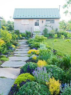 Plantings and pathway lead to the backyard shed