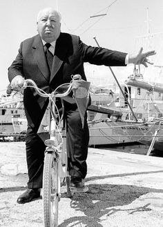 """vintagegal:  """" Alfred Hitchcock pedals his bicycle to the Cannes film festival, 1972  """""""