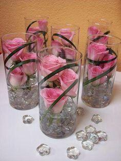 Pink rose in cylindars