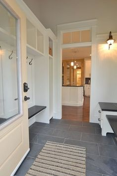 large, rectangular slate-gray tile for the laundry/mudroom and half bath