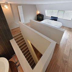 Modern attic bedroom stylish house renovation on Archinspire. Loft Stairs, House Stairs, Open Stairs, Basement Stairs, Minimalist Fireplace, Attic Inspiration, Attic Bedrooms, Loft Room, Attic Renovation