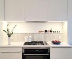 Installation Inspiration - Heath Ceramics white (2x12) tile in g1o7 mid century white, variation 3