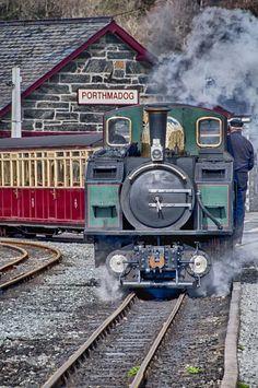 Porthmadog, Wales. Steam train leaving Porthmadog Station.