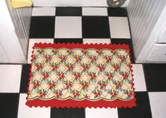 Check out this rug - so cottage cute - and made by hand with a tea towel!  Genius!