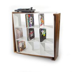 Extended Play turntable and record collection friendly shelf from Fixed Design.  The shelves are angled in a way so you can stack your LP's and not even worry about them falling over!