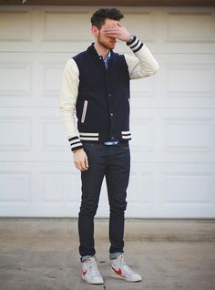Letterman jacket and high tops.