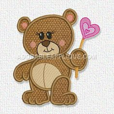 This free embroidery design is a bear holding a heart.
