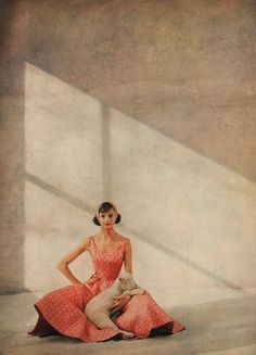 Late 1950s fashion photo from Harpers Bazaar April 1959 of  Anne Fogarty wearing a pink beach club dress, lightly printed over the pink are clover blossoms in full, white bloom. Photographed by Francesco Scavullo.