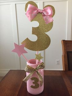 Pink and gold Minnie age center piece by BlueSpringsBoutique Minie Mouse Party, Minnie Mouse First Birthday, Minnie Mouse Theme, Mickey Party, 3rd Birthday Parties, Birthday Party Decorations, Pink Mason Jars, Pink And Gold, Ideas Party