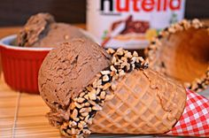 We love Nutella! Whether it's on pancakes, waffles, or simply spread onto a slice of bread, it's something no one gets tired of. What would be even better would be Nutella ice cream! Here's how to make it at home, WITHOUT an ice cream churner! Frozen Desserts, Frozen Treats, Ice Cream Churner, Yummy Treats, Sweet Treats, Yummy Food, Yummy Ice Cream, Nutella Recipes, Frozen Yogurt