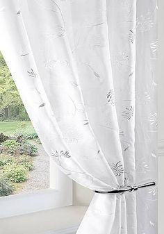 wilton white, embroidered voile curtain fabric from £9.00 per metre.