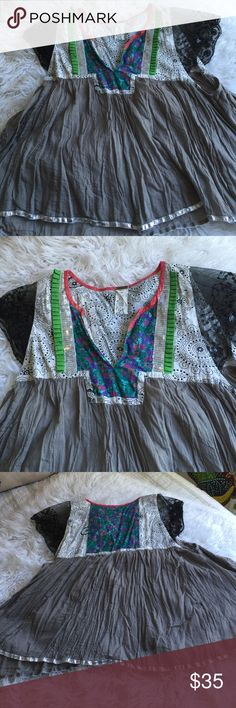 Free People Vintage smock top Free people top with cool detail of material and sequined cut out lace cap sleeves silver trim/ Free People Tops Blouses
