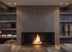 20 Of The Most Amazing Modern Fireplace Ideas interior corrugated material is cool. also having an enormous fireplace with center wood looks surprisingly nice. Linear Fireplace, Home Fireplace, Fireplace Surrounds, Fireplace Design, Fireplace Ideas, Fireplace Mantels, Fireplace Modern, Wood Mantle, Gas Fireplaces