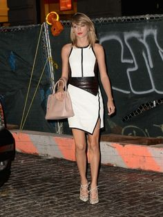 The Summer of Swift: Taylor Swift is rocking a very sophisticated black & white color block dress.