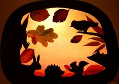 Beautiful window transparency for fall, with leaves, birds and squirrels.