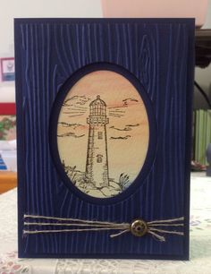 Blessed to Stamp this masculine birthday/Father's Day card. All products are Stampin' Up apart from the lighthouse image which is from Our Daily Bread Designs' Light of the World stamp set. Night of navy and watercolor card stock. Woodgrain em-bossing folder, linen thread and antique brad.