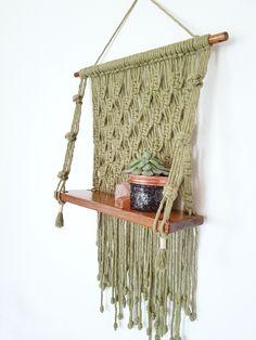 · On trend home decor. Moss green macrame shelf by Green Lane Creative. Available on Folksy. Macrame Design, Macrame Art, Hanging Rope Shelves, Shelf Inspiration, Macrame Plant Holder, Fabric Rug, Macrame Patterns, Etsy, Crafts