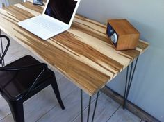 Mid century modern desk featuring wormy maple top and hairpin legs.  Matching sideboard to go with coffee table?