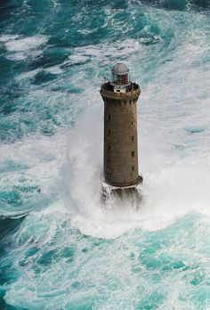 Waves crashing on an abandoned lighthouse on the middle of ocean. Fuerza Natural, Lighthouse Pictures, Stormy Sea, Beacon Of Light, Ocean Waves, Abandoned Places, Belle Photo, Beautiful World, Beautiful Ocean