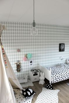 Charming black and white danish modern girls room that's sure to make you smile!