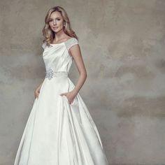 Sleek , modern, modest wedding gown