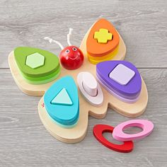 Shop Butterfly Shape Sorter. Allow your little ones' curiosity to soar with the butterfly shape sorter. Featuring 15 pieces in various shapes and colors, it's the perfect way to teach kids. Plus, it'll add a vibrant splash to any nursery or playroom.