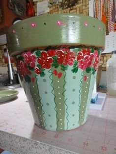 Painted flower pot, geraniums