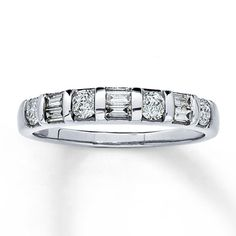 Channel-set round and baguette diamonds are set between bands of 14K white gold to create this stunning fine jewelry anniversary ring for her, with a total diamond weight of 1/2 carat. Diamond Total Carat Weight may range from .45 - .57 carats.