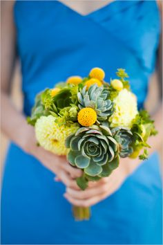LOVE THIS ONE- THIS IS OTHER FAVORITE. I love the green bits and yellow tufts, and the succulents. The shape is more of what I envision the matron of honors, but then I don't want the bride's to be too big, either. The color combo (blue-ish succulents, bright greens and yellows) is perfect!