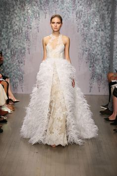 MONIQUE LHUILLIER  2016...Wow love the embellishments. Make sure your bridal embellishments fits your style. The sky is the limit.