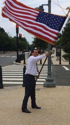 Ted Cruz, waving American Flag.. imagine Obama EVER doing this... Definitely not, BO's hates America, besides which, he's the WORST president EVER!!!