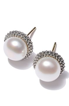 Captivated by the beauty of these LAGOS 'Luna Pearl' small stud earrings.