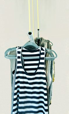 Easy DIY from The Design Confidential for Sleek Hanging Closet Rods